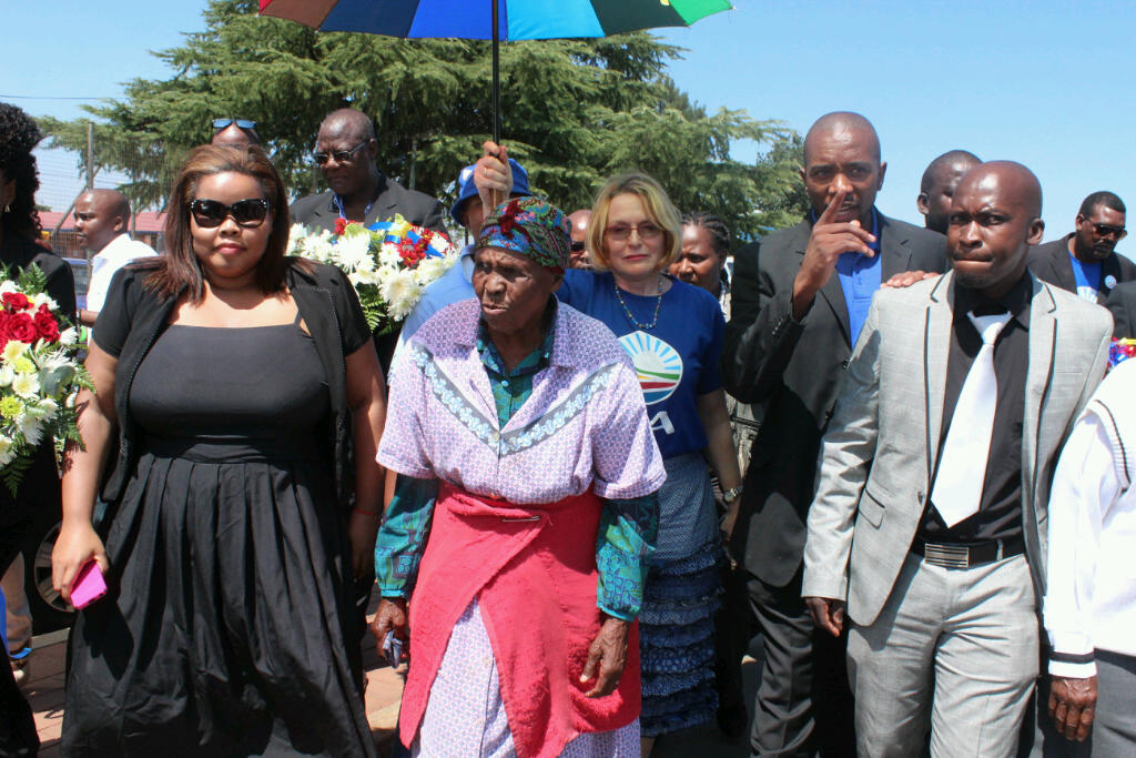 Democratic Alliance leaders with an elder at the 53rd Sharpeville massacre commemoration.