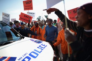 Protesters outside the University of Johannesburg, Soweto Campus got involved in a heated altercation with the police who ended up using rubber bullets to disperse the crowd. – image - www.guardian.co.uk