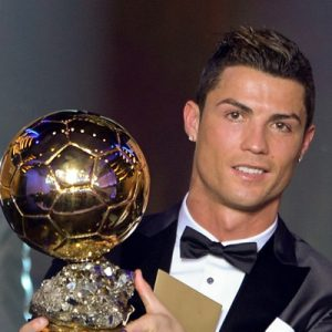 Christiano Ronaldo with the FIFA Ballon d'Or award.  Image: The DNA India.