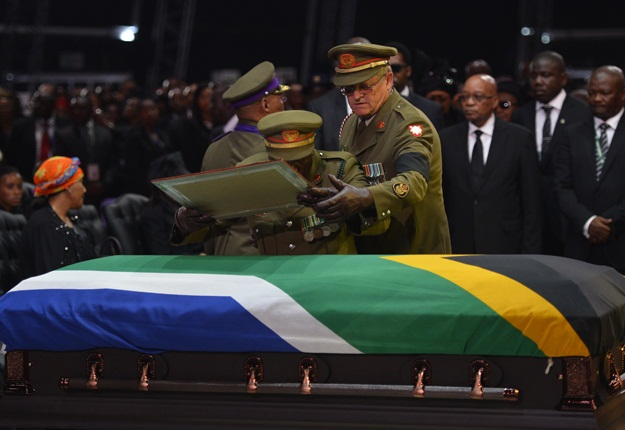 The coffin of former South African President Nelson Mandela lies at the dome where his funeral was held at his family home in Qunu, Eastern Cape. – image – News24