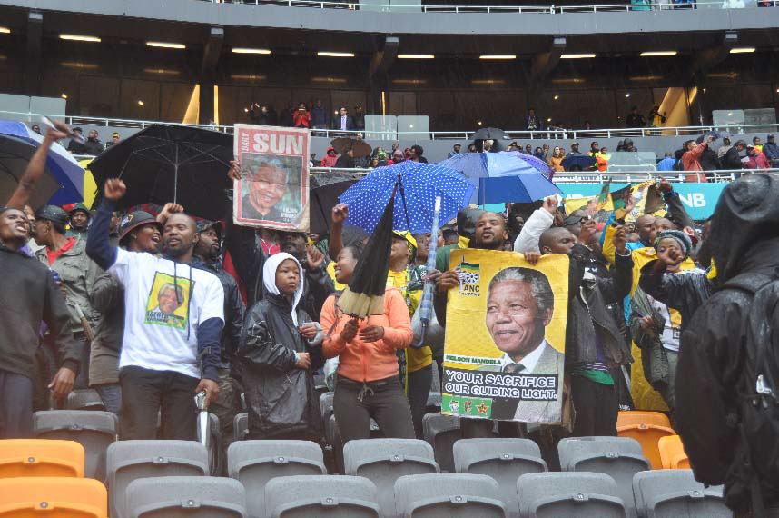 People braved the rain to pay their respects to the late Nelson Mandela at the FNB Stadium on Tuesday. – image – Ntokozo Sindane