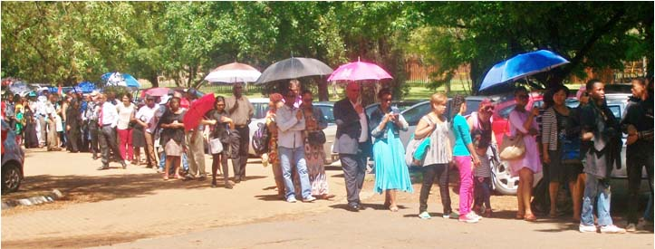 Members of the public stood in a queue at one of the Park and Ride facilities waiting for a bus to the Union Buildings where former President Nelson Mandela lies in state. – image – Ntokozo Sindane