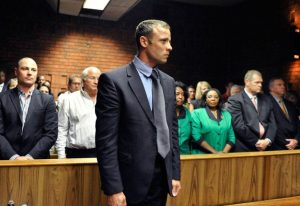 Murder accused Oscar Pistorius stands ready to face the charges against him. – image – www.news24.com.