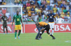 Referee Lwandile Mfiki under attack by a disgruntled Kaizer Chiefs fan wielding the much-loved vuvuzela. – image - www.ghanamma.com