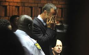 Oscar Pistorius shown reacting to the prosecutor's charge of premeditated murder. This picture was taken against the magistrate's ruling of no recordings while the court is in session. Image – www.telegraph.co.uk