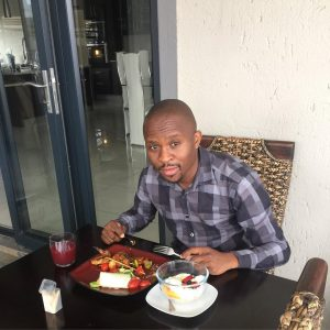 Jabulani Ngcobo enjoying a meal prepared by his in-house chef at his upmarket house in Johannesburg.