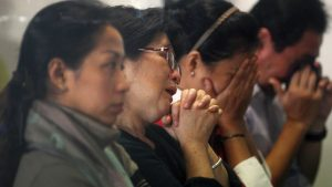 Relatives of those in Flight QZ8501 overcome by emotion as they await news about their loved ones.  Image: ABC News.
