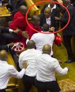 Captain Walter Prins as he engages with Malema and Shivhambu. Image: News24