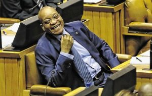 President Zuma cannot help smiling as the opposition digs into his SONA.  Image: News24