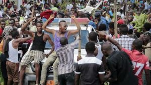 Demonstrators dance for joy on the streets in Burundi as news of the coup spreads.  Image: APP