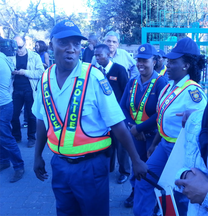 The South African Police Services control the crowd outside the hospital. – image – The Public News Hub