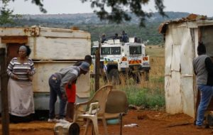 Police were at the scene of land grabs and stopped people occupying private land with rubber bullets after people started throwing stones.  Image: Timeslive.